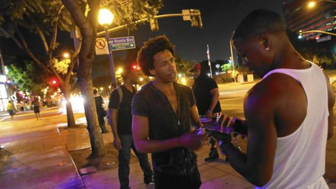 Thomas Davis spends a night in September asking people in West Hollywood to participate in a UCLA study about mobile apps and their ability to help improve health and combat disease. (Michael Robinson Chávez)