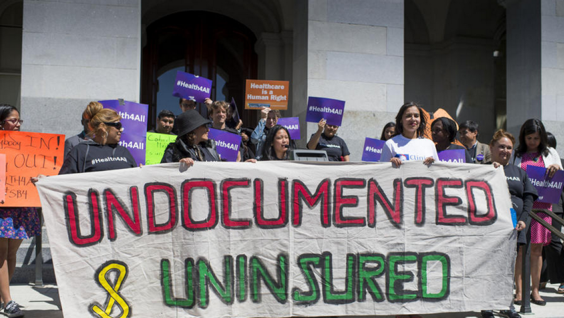 Advocates for a bill to provide healthcare to undocumented immigrants rally in at the Capitol in Sacramento. (Hector Amezcua)