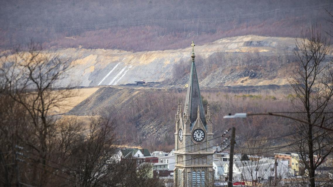 The steeple of the now closed St. Katharine Drexel Roman Catholic Church stands out in front of the skyline of Lansford as you e