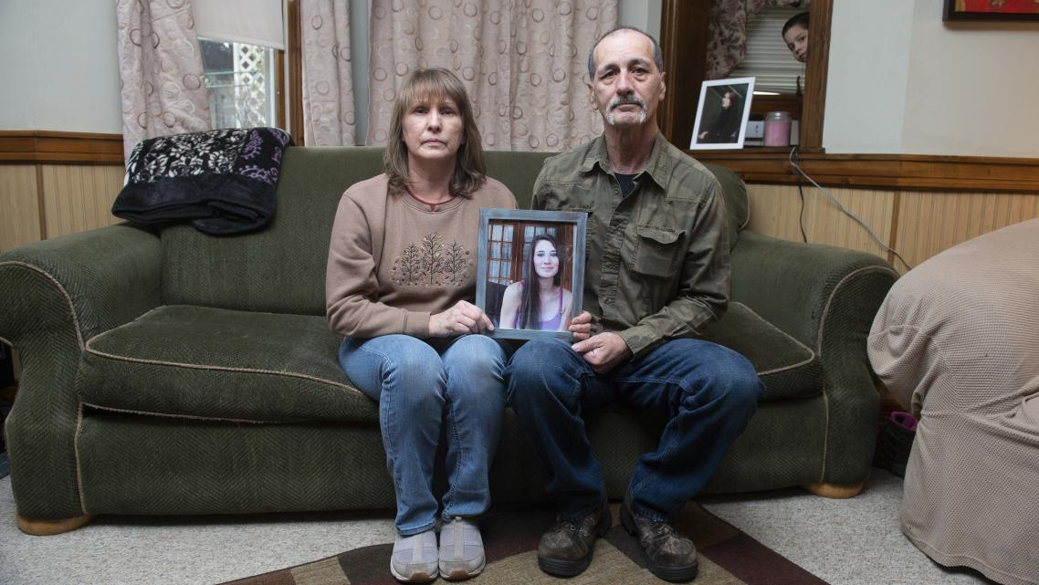 Kay and Jon Steigerwalt sit in the living room of her Palmerton home, holding a photograph of their daughter Deanna. Deanna died