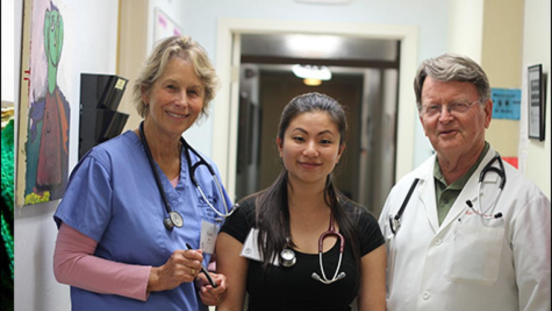 Kate Ratcliff and Amy Chao volunteer as nurses at RotaCare Richmond Free Medical Clinic at Brighter Beginnings. Dr. Pate Thomson, right, is the medical director in charge of adult care and a retired cardiologist. Photo by Momo Chang