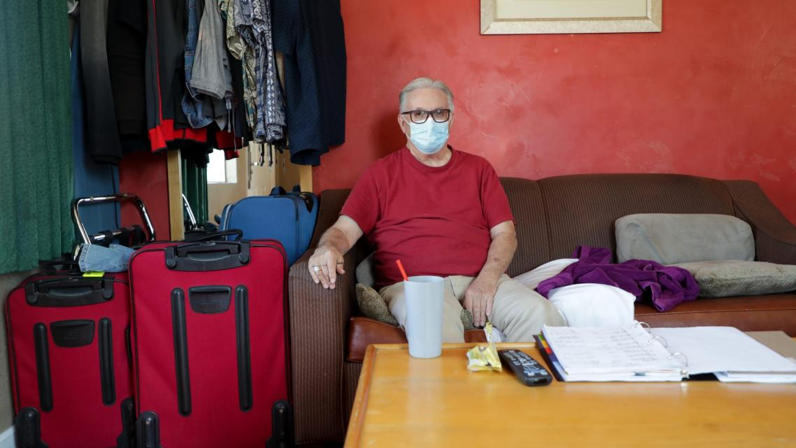 Lee Fournier sits in his hotel room provided by Project Roomkey on Sunday, October 11, 2020, at Rodeway Inn & Suites in Indio, C