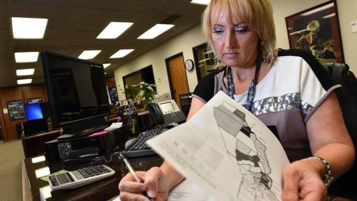 Kayla Wilson, who teaches sex education courses throughout Fresno County, at work in her office at the Fresno County Office.
