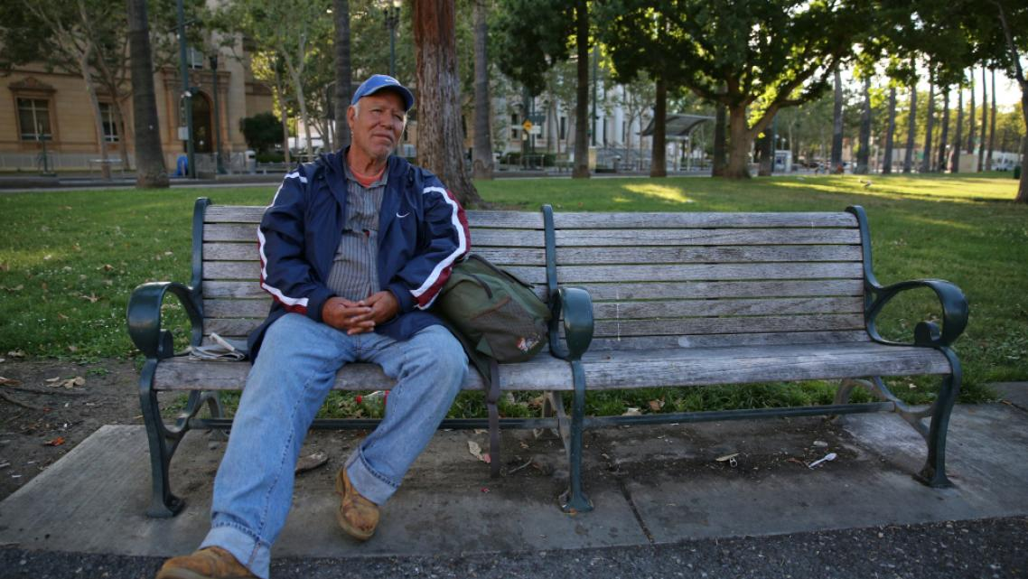 A man named Roberto sits on a bench at St. James Park in San Jose, Calif., on June 7, 2016
