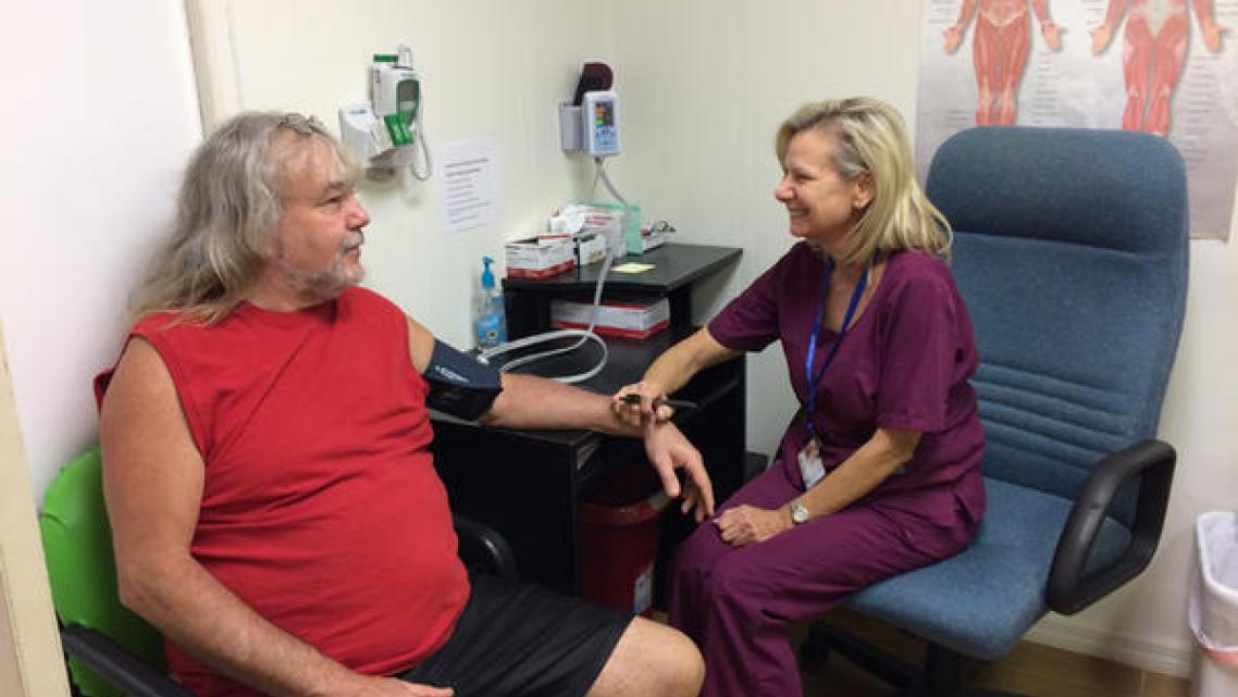 Kim Harden takes a patient's blood pressure at the Lake Wales Free Clinic. Julio Ochoa/WUSF