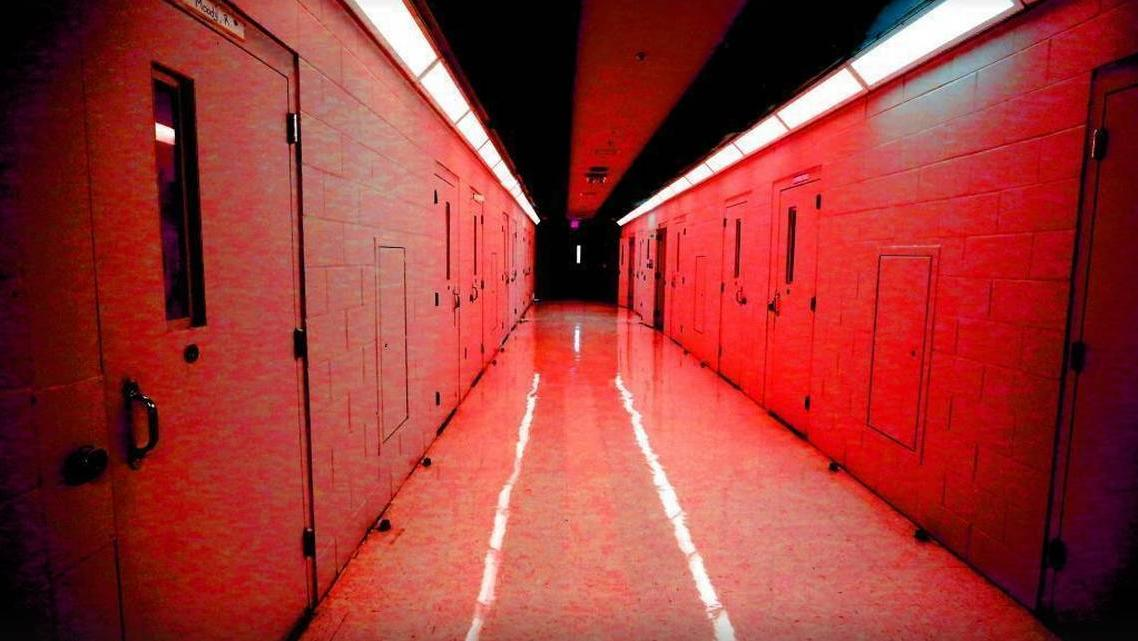 In this photo illustration, a hallway of cells is shown at the Palm Beach Youth Academy in West Palm Beach. Emily Michot