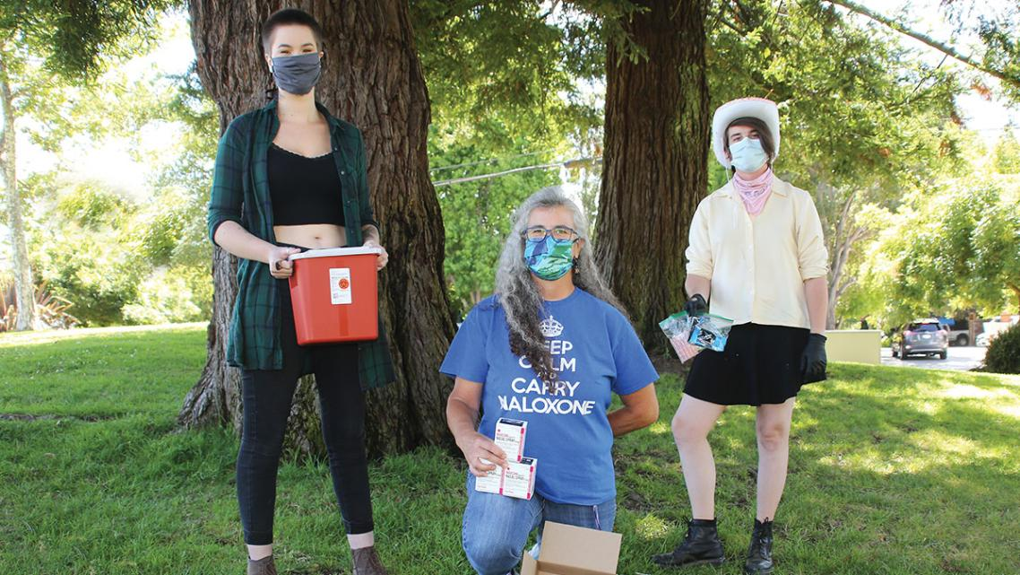 FROM LEFT, HARM REDUCTION COALITION VOLUNTEERS KATE GARRETT, DENISE ELERICK AND DANI DRYSDALE.