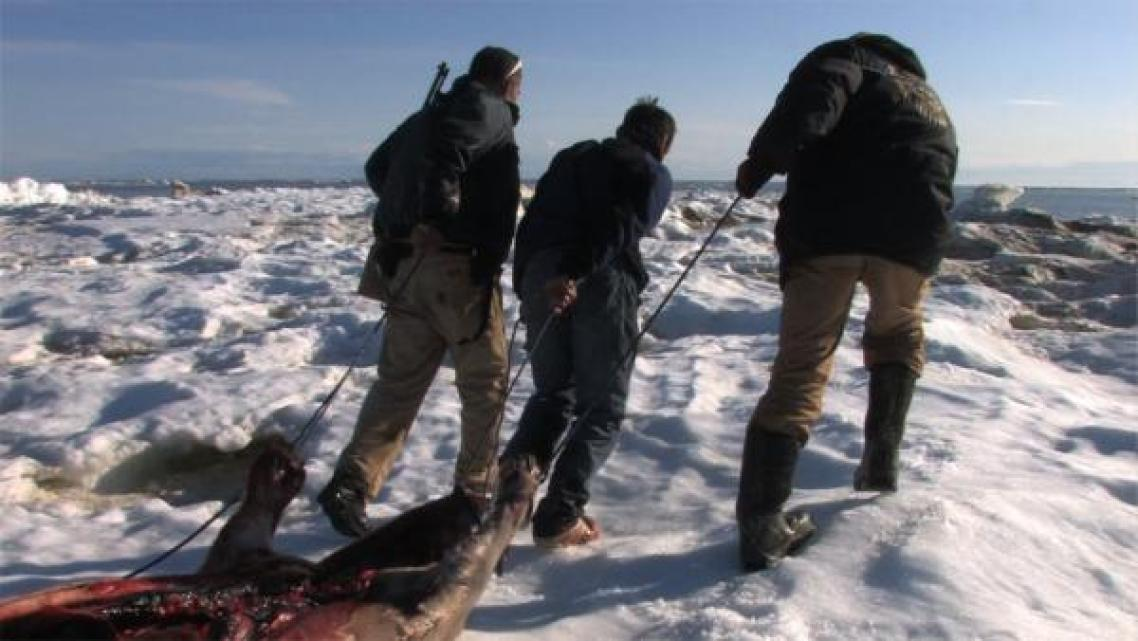 Keggulluk (left) and Evon Peter (right) after a successful seal hunt. (Marsh Chamberlain)