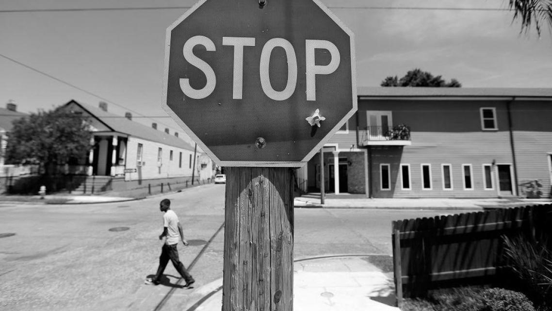 A bullet hole in a stop sign at the corner of Dryades and Fourth streets is a daily reminder of violence.