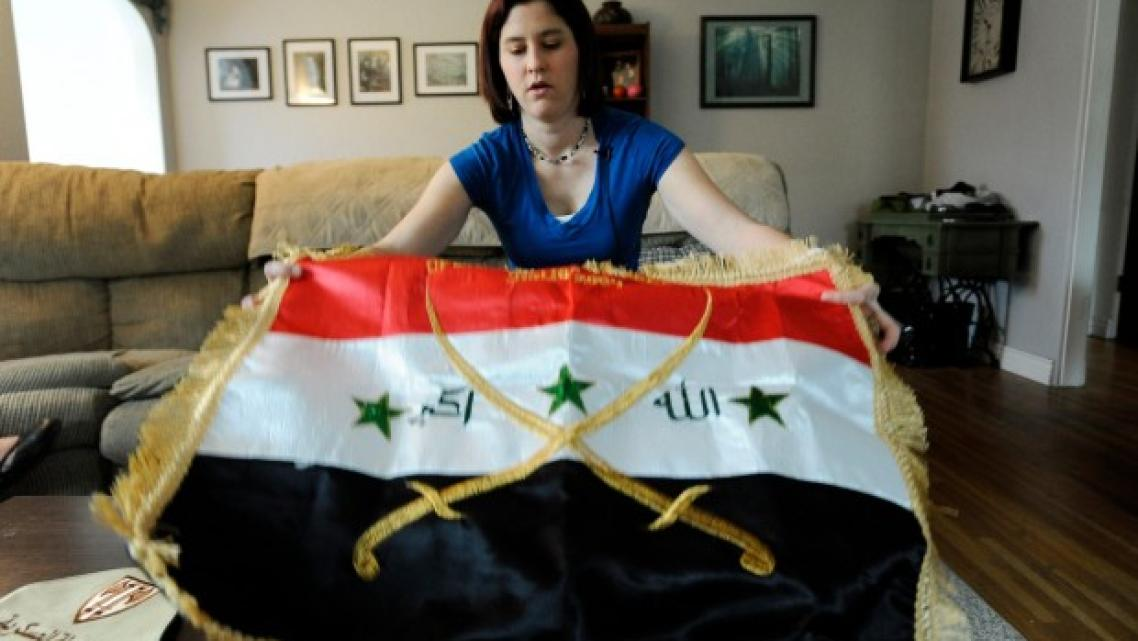 Former U.S. Army Spc. Casey Elder, a veteran of the Iraq war, shows an Iraqi flag that she bought in Baghdad. Elder, a Purple Heart recipient, suffers from post-traumatic stress disorder and traumatic brain injury. A roadside bomb struck her Humvee in Baghdad.