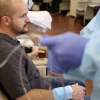 Dustin Wallis, a 39-year-old nonsmoker, receives an infusion to treat stage 4 lung cancer at Utah Cancer Specialists.