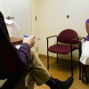 """A patient talks about her depression to therapist Neil Martin at T.H.E. Clinic in South Los Angeles. """"It's so linked, physical and mental health,"""" Martin said. (Gina Ferazzi, Los Angeles Times)"""