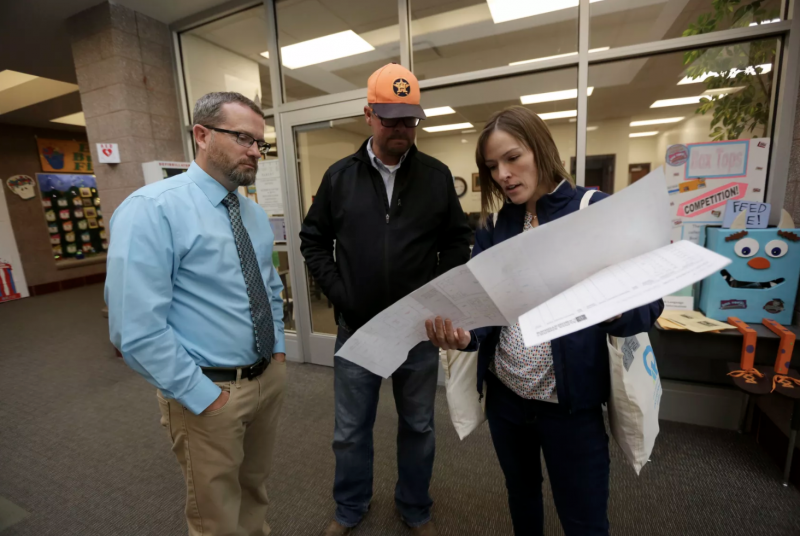 Ephraim Elementary principal Gannon Jones, Ephraim Elementary custodian Tyler Alder and Deseret News special projects reporter Sara Israelsen-Hartley look over a map of the school while preparing to put radon test kits in classrooms in Ephraim Elementary School in Ephraim on Tuesday, Oct. 8, 2019. Kristin Murphy, Deseret News