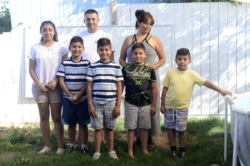 """The Gutiérrez family: Jerry and Alma with their children from left, Gloria, 13, Juan, 9, Julian, 8, Gabe, 7, and Diego, 6. Jerry, 17, not pictured. With four children under 12, not yet old enough to receive the vaccine, the family continues to take every precaution while also enjoying family time. """"We'll probably have a party [to celebrate when] Covid's over."""" says Juan. Dana Ullman / The Mendocino Voice"""