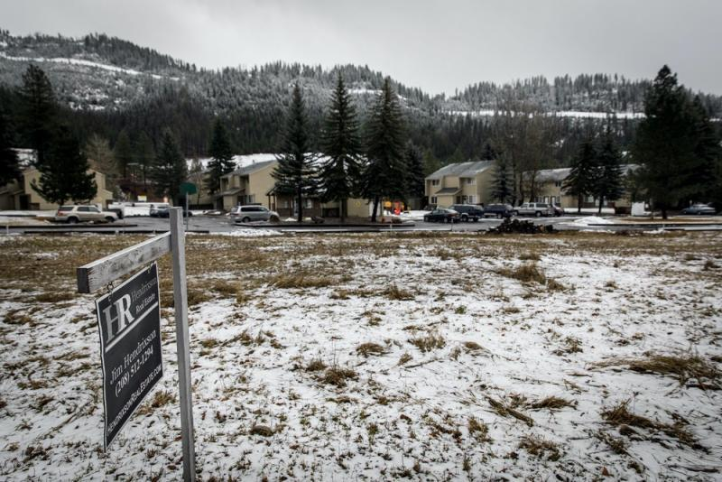 An empty field and a playground at Canyonside Townhouses, seen on Jan. 5, 2021, is the primary area where children of the public housing complex play in Wallace, Idaho. Photo: Rebecca Stumpf for The Intercept