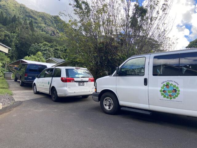 At Ho'oulu 'Aina, vans line up to deliver food to families in need. More than 21% of Kalihi residents had filed for unemployment by May.