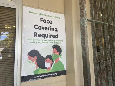A sign at Kuhio Park Terrace urges everyone to wear face masks.