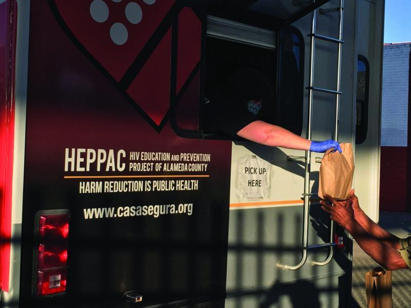 Community members collect supplies from HEPPAC in Fruitvale. (Ariel Boone)