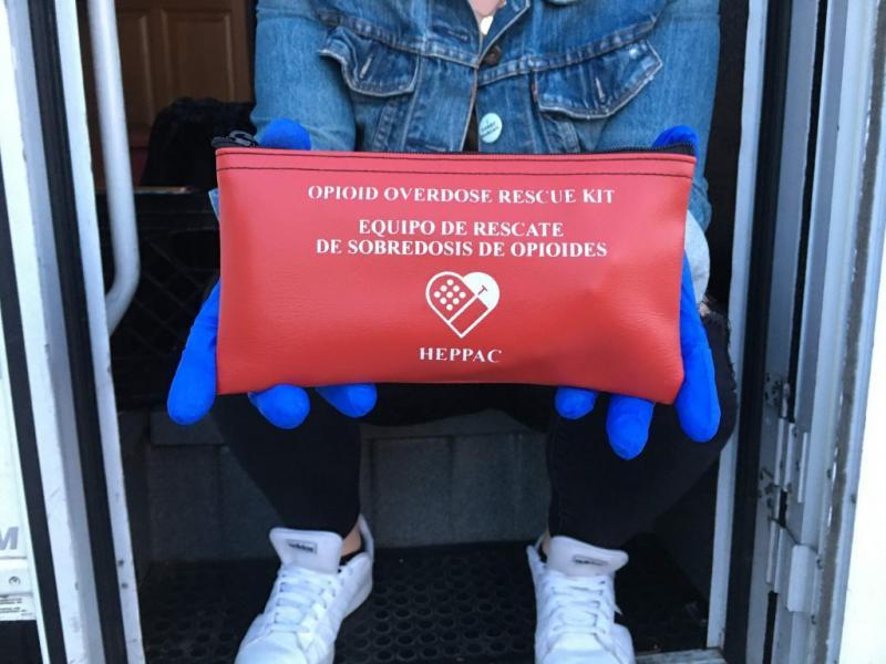 Opioid overdose rescue kits are distributed during HEPPAC outreach in Fruitvale. (Ariel Boone)