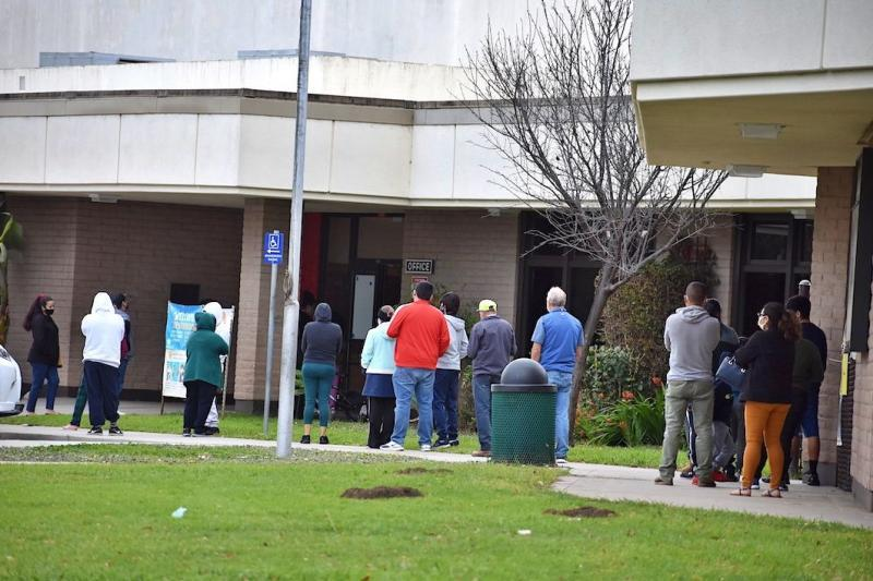 Neighborhood residents line up to receive COVID-19 tests at Franklin School on Santa Barbara's Lower Eastside as part of the Santa Barbara County Public Health Department's outreach efforts. (Brooke Holland / Noozhawk photo)