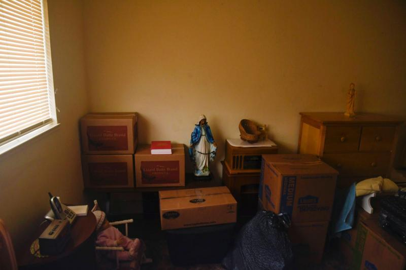Stacked boxes full of belongings fill the cramped bedroom of Martinez's apartment. Aug. 7, 2020. Ayrtron Ostly/The Californian