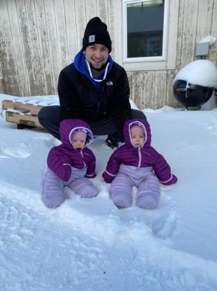 Twins Anna and Mila with their father, John Melovidov, in St. Paul. (Image courtesy of the family)