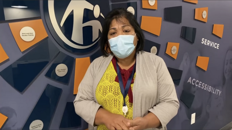 Irene Maun Sigrah, a Marshallese health worker at Crescent Community Health Center, records a public service announcement in November 2020 about how to stay safe from Covid-19 during the holidays. | Crescent Community Health Center