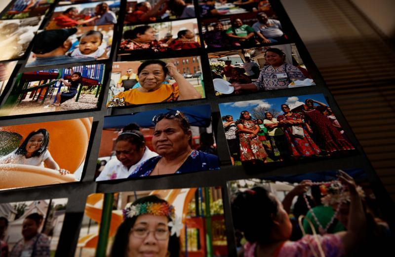 Pictures hang on a wall showcasing members of the Marshallese community now living in Dubuque, Iowa. | M. Scott Mahaskey / POLITICO