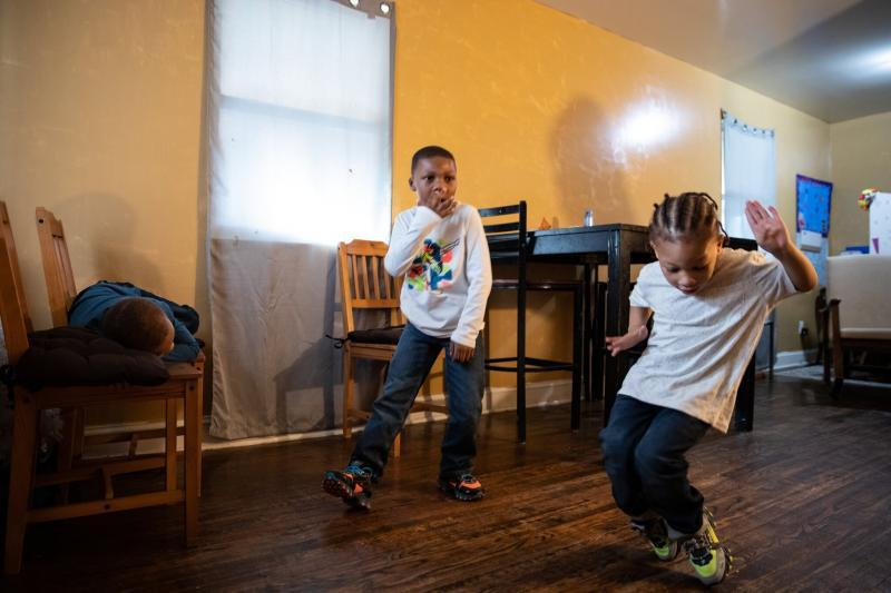 Jermiah, 6, and Markette, 4, danced in their home. Their mother, Ms. Porter, schedules story time and dance time, and helps her children with reading, math and science.Credit...Cheriss May for The New York Times  Image