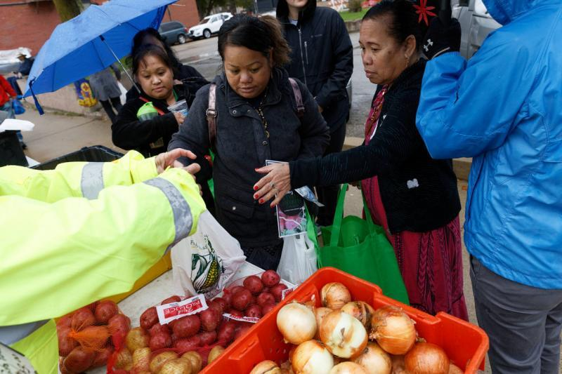 Residents of the Marshall Island community living in Iowa take advantage of a pre-COVID food program to purchase items at a farmer's market October 5, 2019 in Dubuque, Iowa. | M. Scott Mahaskey / POLITICO