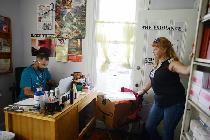 Patti Parker, an outreach and harm reduction service provider, checks in with Shawn Horn before heading out to do outreach in Ukiah on July 15, 2021. (Photo by Dana Ullman/ The Mendocino Voice)
