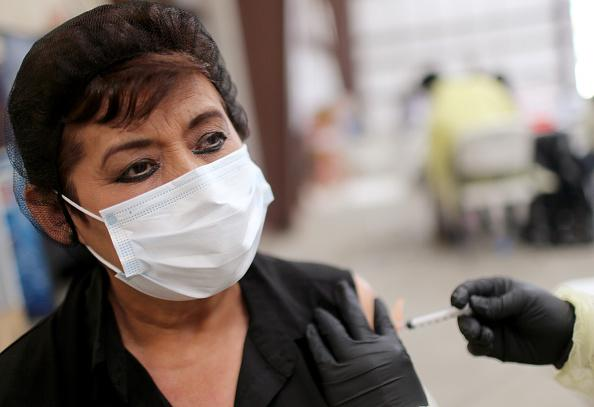 Guadalupe Aguirre receives a dose of the Johnson & Johnson Covid-19 vaccine at a clinic for agriculture workers on April 5, 2021 organized by TODEC Legal Center in Riverside, Calif. The county made farmworkers eligible for vaccines in January, alongside teachers and seniors, as they face an increased risk of contracting Covid-19. (Photo credit: Mario Tama, Getty Images)