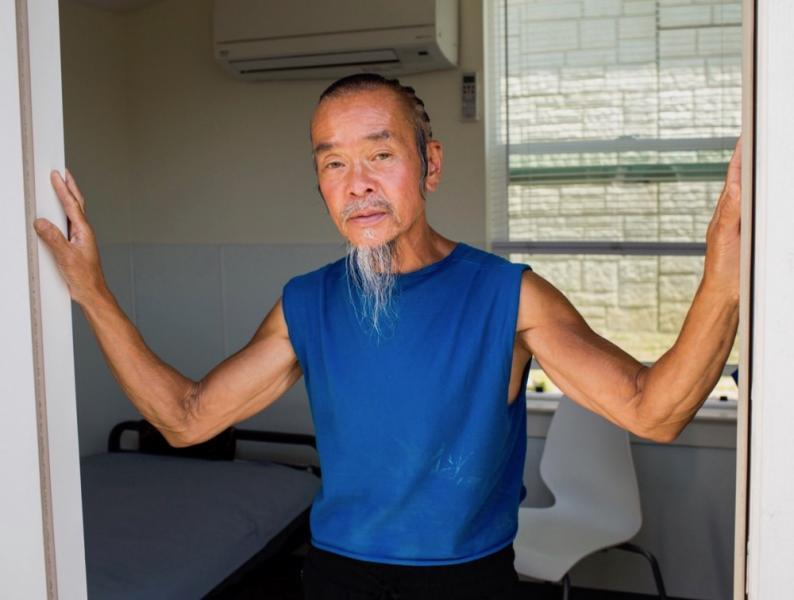 Nguyen, 59, lived with friends and relatives until a recent eviction. He rides his bike from the tiny home community to his job at a nearby Amazon warehouse. (Photo: Pamela Gentile)