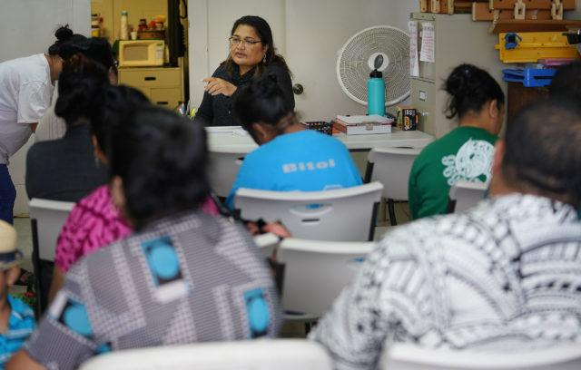 Josie Howard from Chuuk assists her fellow citizens of COFA nations with enrolling in health care insurance at We Are Oceania's office in Kalihi in December 2018. Cory Lum/Civil Beat