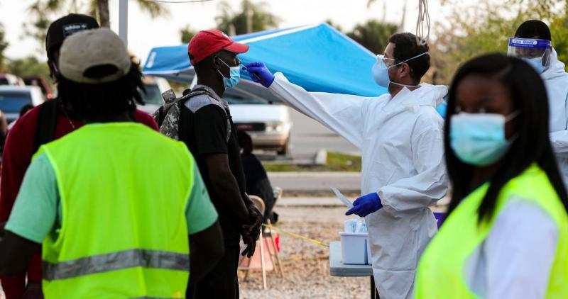 Edwin Canas administerss a COVID test to a farmworker. Busses drop off migrant farmworkers in the center of town, near CIW and Mission Peniel, in Immokalee. COVID-19 Rapid tests, education and results are provided by a Healthcare Network, CIW, working together with PIH to address the unique needs of this heavily immigrant community. Andrea Melendez/The News-Press/USA Today, Florida Network