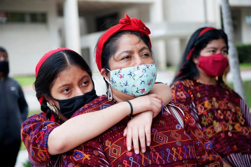 Sindia Vasquez, 13, Juana Lopez and Flor Perez, 14, all of Lake Worth attend the Public Prayer to Honor Farmworkers Lost Due to COVID-19 event at the Saturday March 27, 2021 at the Palm Beach County Health Department in West Palm Beach. Meghan McCarthy, MEGHAN McCARTHY/Palm Beach Daily News