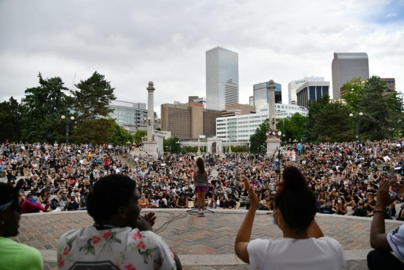 A child speaks to the crowd during a gathering at Civic Center Park in Denver on Thursday, June 4, 2020. Hyoung Chang, The Denver Post