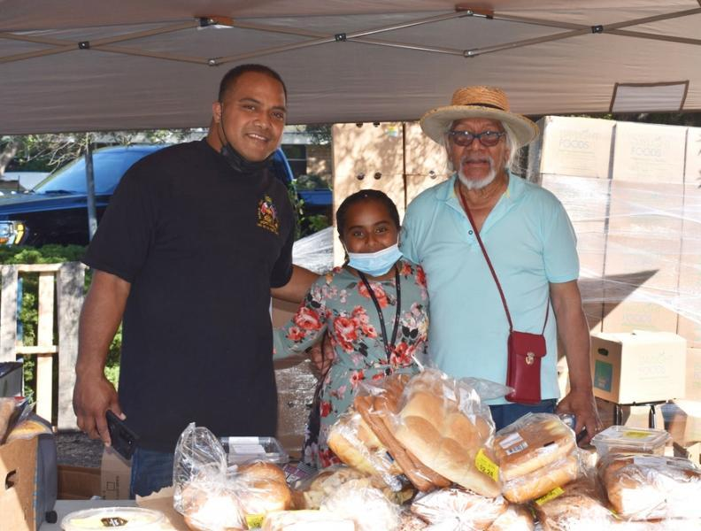 From left, Rev. Saulisi Kanongata'a, daughter Moala and family member Senita Uhilamoelangi are shown at the pop-up food distribution site they volunteer at in the parking lot of the St. Andrews United Methodist Church in Palo Alto, where Kanongata'a is pastor. Photo by Kate Bradshaw.