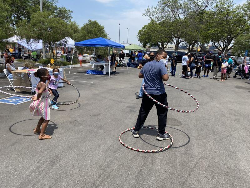 Kids play with hula hoops at a Black Health Fair in North Long Beach on July 24. Photo by Kelly Puente.