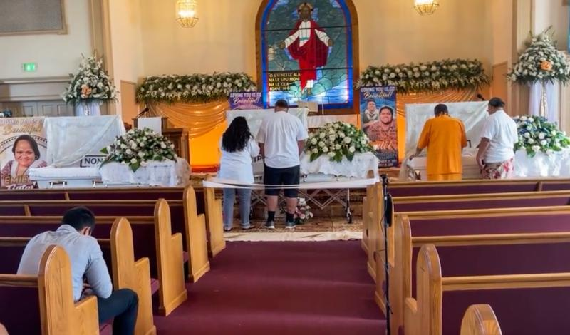 """Mourners on Aug. 27, 2021 remember 23-year-old twin brothers Joel """"Seali'i"""" Savea and Joey """"Faleono"""" Savea and their cousin Emily """"Fia"""" Memea, 40, who all died of COVID. The three were beloved members of the Fourth Samoan Congregational Christian Church of Long Beach. Photo courtesy of Fourth Samoan Congregational Church."""