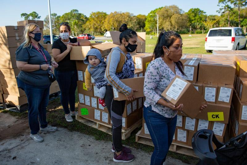 Community members collect boxes containing food during a homeless count in January hosted by the Collier County Hunger and Homeless Coalition at Guadalupe Social Services in Immokalee. JON AUSTRIA/NAPLES DAILY NEWS USA TODAY NETWORK - FLORID