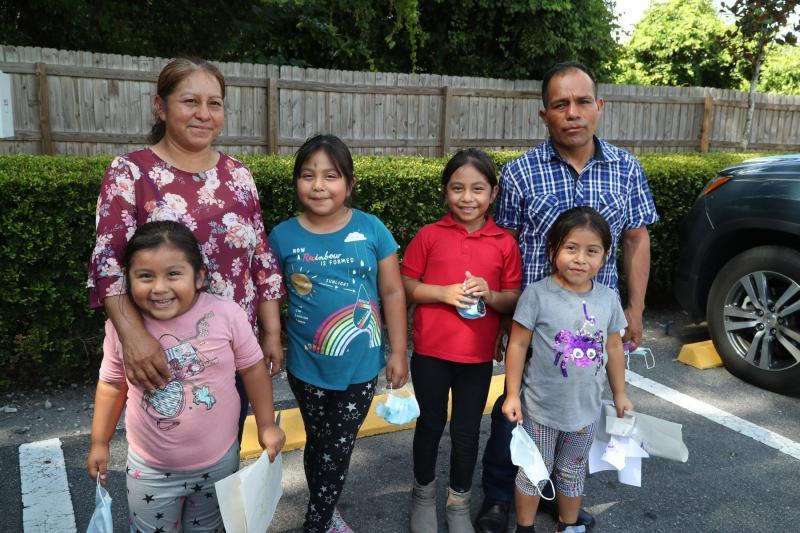 Jesus Hernandez and his wife, Julia, both farmworkers in the Plant City area, with their daughters Zaira, 4, Yaretzi, 7, Yareli, 7, and Yulisa, 5. The couple struggled to help their older girls with worksheets sent home when school closed because neither speaks English and homework instructions were in English and their girls don't yet read. ANDREA MELENDEZ/THE USA TODAY NETWORK-FLORIDA