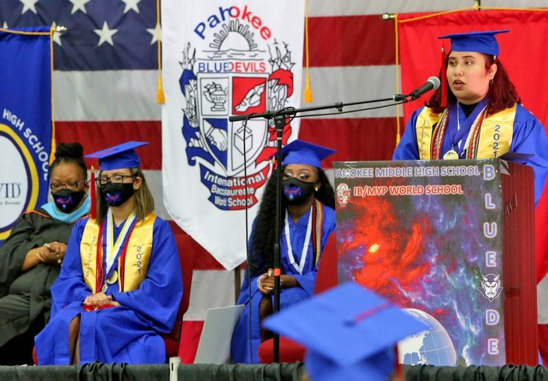 Jasmine Calderon, Pahokee High School's valedictorian, delivers her commencement speech during graduation at the South Florida Fairgrounds. TIM STEPIEN/THE PALM BEACH POST