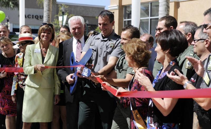 Pasco Sheriff Chris Nocco cuts the ceremonial ribbon during the opening ceremony for a new Sheriff's Office substation at a local mall. Times (2012)