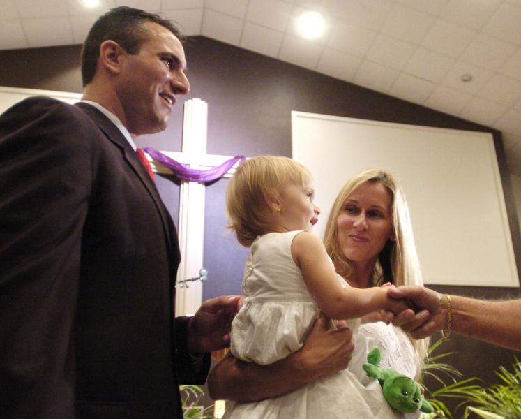 Sheriff Chris Nocco, his wife Bridget Nocco and their daughter attend the sheriff's swearing-in ceremony in 2011 at Redeemer Community Church in New Port Richey. Times (2011)