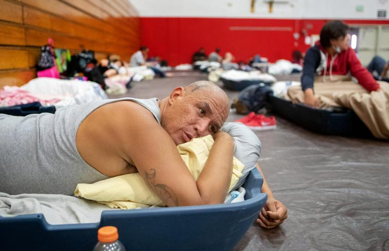 Johnny Alvarez, 47, rests inside the emergency overnight shelter run by the Coachella Valley Rescue Mission inside a portion of the Palm Springs High School Gymnasium on Saturday , June 27, 2020. Taya Gray, Taya Gray