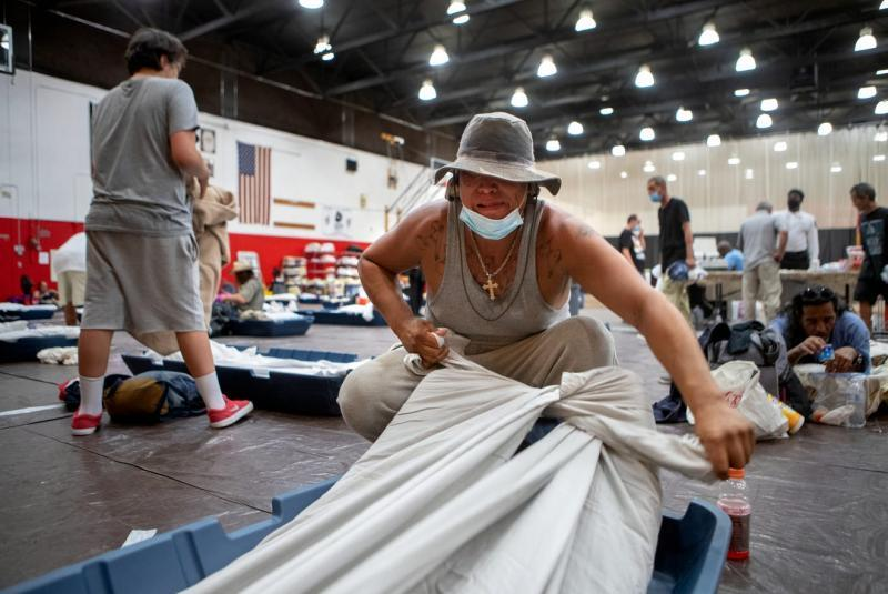 Johnny Alvarez, 47, secures a sheet to his mattress inside the emergency overnight shelter run by the Coachella Valley Rescue Mission inside a portion of the Palm Springs High School Gymnasium on Saturday , June 27, 2020. Taya Gray, Taya Gray