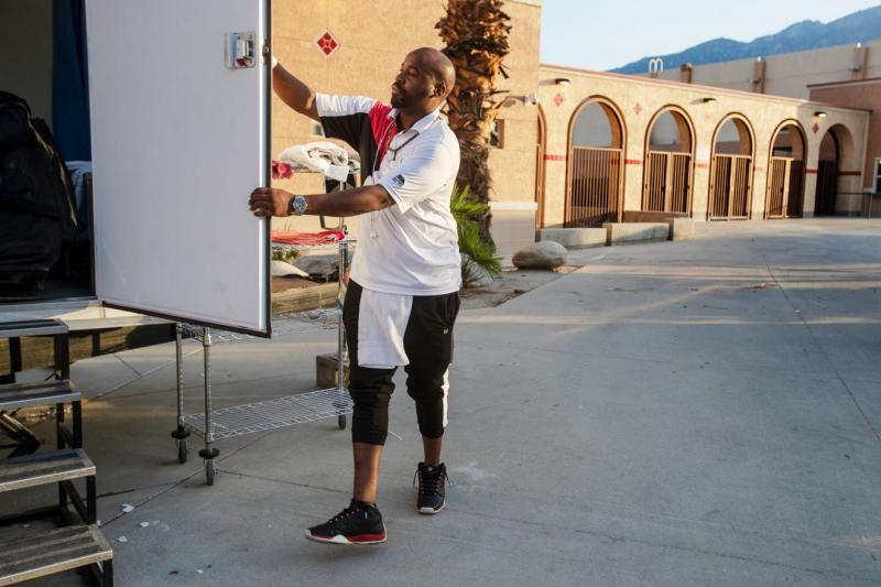 Coachella Valley Rescue Mission employee Charles Dangerfield the third closes the door to the portable shower used by guest staying at the emergency overnight shelter run by the Coachella Valley Rescue Mission inside a portion of the Palm Springs High School Gymnasium on Saturday , June 27, 2020. Taya Gray, Taya Gray