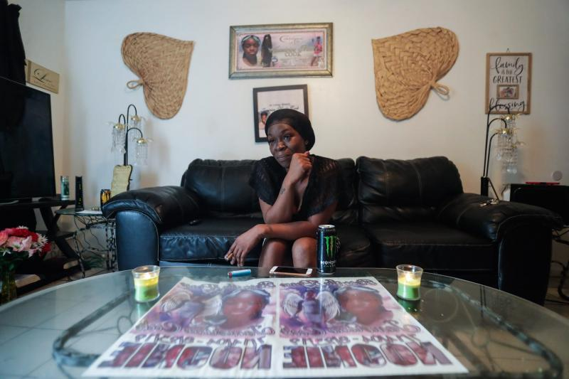 "Koquisha Cook, 36, sits in her living room as she shares fond memories of her daughter Jamirica ""Noonie"" Cook, 15, who was shot and killed last year in her home in the Springfield Apartment complex. Photographs and tributes to Noonie decorate Cook's home. ALICIA DEVINE/TALLAHASSEE DEMOCRAT"