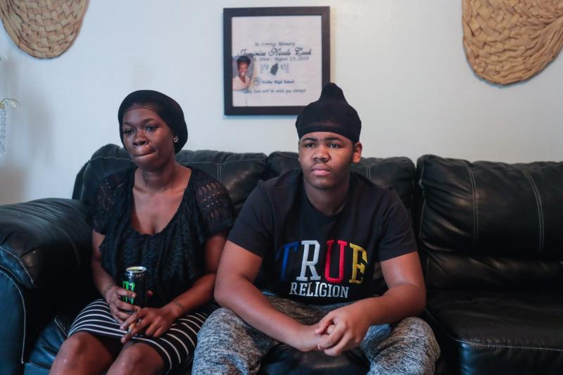Koquisha Cook, 36, sits with her son Matthew Cook, 17, in their living room. Matthew is facing charges on the shooting and killing of his sister last year. ALICIA DEVINE/TALLAHASSEE DEMOCRAT